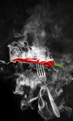 Czerwona papryczka Chilli na widelcu